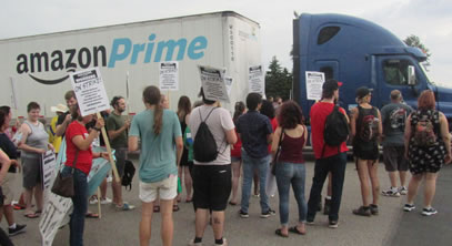 Picketers blocked a truck from entering the driveway to Amazon's fulfillment cener in Shakopee